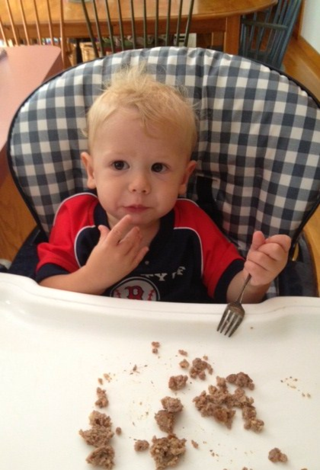 Coleman eating meatballs